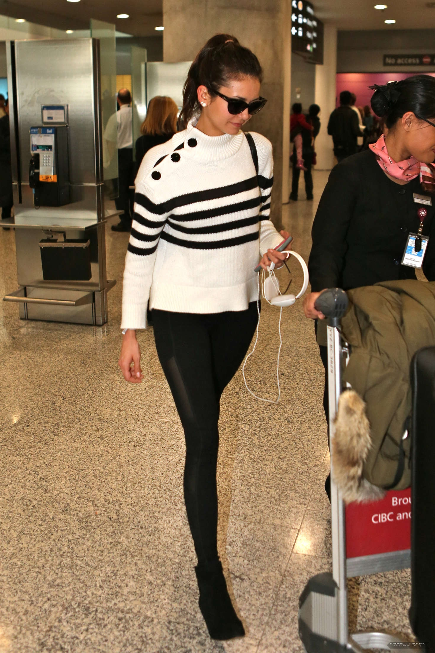 Nina-Dobrev-at-Pearson-International-Airport--11.jpg